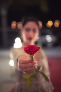 apology from woman with rose